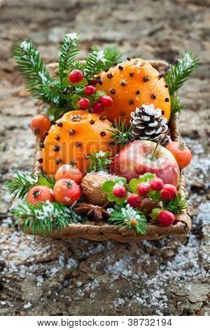 Christmas basket with fruits, berries and nuts