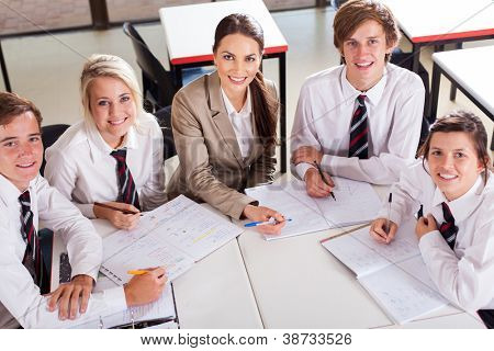 overhead view of high school teacher and students in classroom