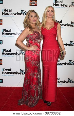 """LOS ANGELES - OCT 21:  Adrienne Maloof, Camille Grammer arrive at """"The Real Housewives of Beverly Hills"""" Season three premiere event at Roosevelt Hotel on October 21, 2012 in Los Angeles, CA"""
