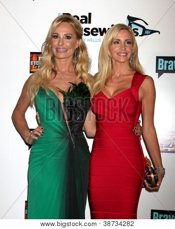 """LOS ANGELES - OCT 21:  Taylor Armstrong, Camille Grammer arrive at """"The Real Housewives of Beverly Hills"""" Season three premiere event at Roosevelt Hotel on October 21, 2012 in Los Angeles, CA"""