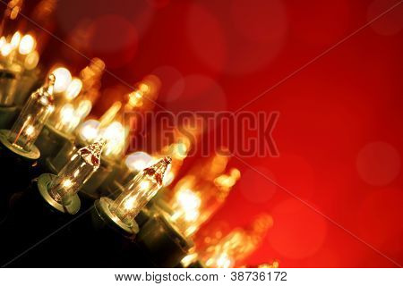 Christmas lights on red background with copy space