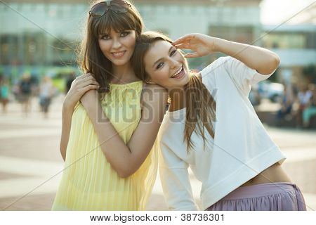 two happy females laugh and have good time together