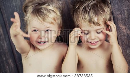Two little boys on the floor