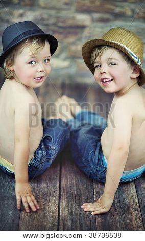 Two little boys sitting