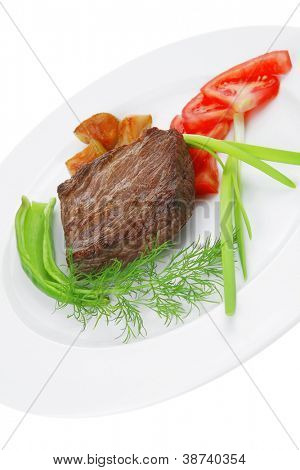 business lunch meat food : roasted fillet mignon on white plate with tomatoes apples and chili pepper isolated over white background