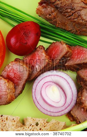 business lunch meat food : bbq meat served on green plate with tomatoes and sprouts isolated on white background
