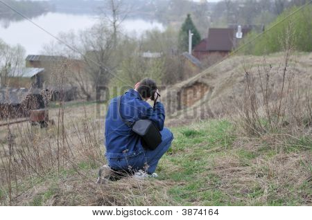 Photografer Dressed In Jeans