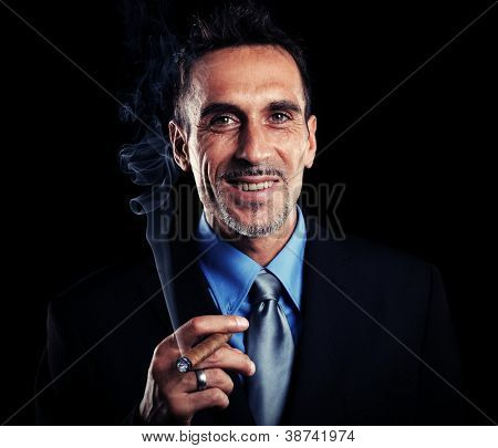 Portrait of a successful businessman smoking a cigar