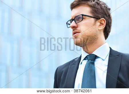 Portrait of an handsome businessman outdoor in the city