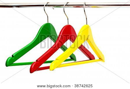 close up of colorful cloth hangers in row on white background