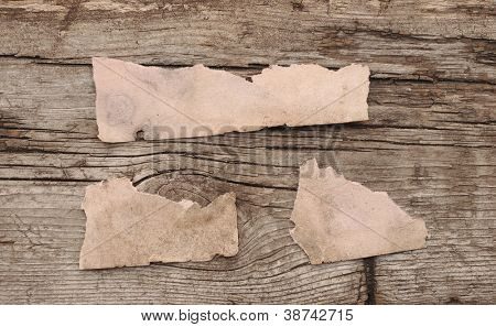 torn paper on wooden background with place for your message