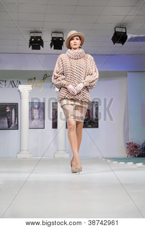 MOSCOW - NOVEMBER 4: Model in unusual sweater in fashion house of Slava Zaitsev on November 4, 2011 in Moscow, Russia.