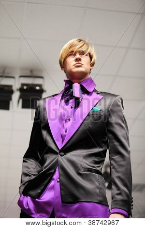 MOSCOW - NOVEMBER 4: Man in a satin jacket on show of designer Slava Zaitsev in fashion house of Slava Zaitsev on November 4, 2011 in Moscow, Russia.