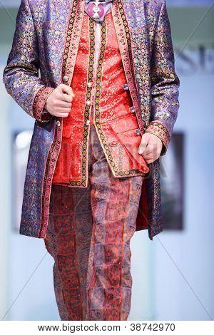 MOSCOW - NOVEMBER 4: Details of bright men suit on show of designer Slava Zaitsev in fashion house of Slava Zaitsev on November 4, 2011 in Moscow, Russia.