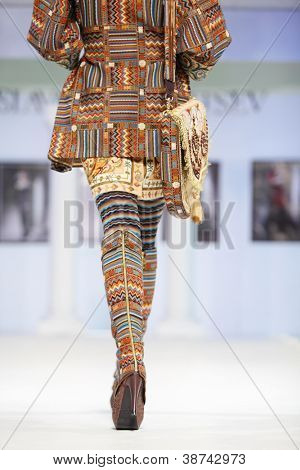 MOSCOW - NOVEMBER 4: Back of model in suit with ethnic pattern on show of designer Slava Zaitsev in fashion house of Slava Zaitsev on November 4, 2011 in Moscow, Russia.