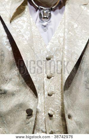 MOSCOW - NOVEMBER 4: Details of golden men vest and jacket on show of designer Slava Zaitsev in fashion house of Slava Zaitsev on November 4, 2011 in Moscow, Russia.
