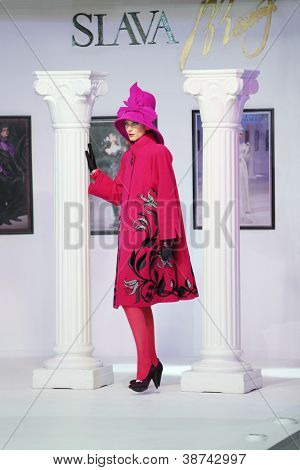 MOSCOW - NOVEMBER 4: Model in pink coat on show of designer Slava Zaitsev in fashion house of Slava Zaitsev on November 4, 2011 in Moscow, Russia.
