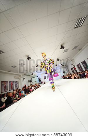 MOSCOW - NOVEMBER 4: Model in colorful dress on show of designer Slava Zaitsev in fashion house of Slava Zaitsev on November 4, 2011 in Moscow, Russia.