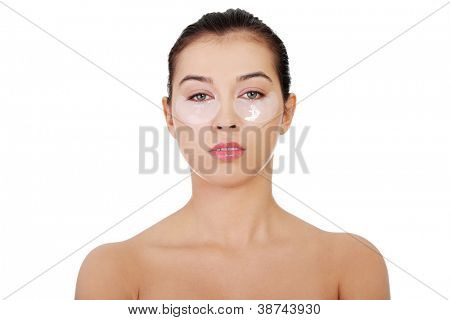 Young beautiful woman with collagen eye lift mask, isolated on white.
