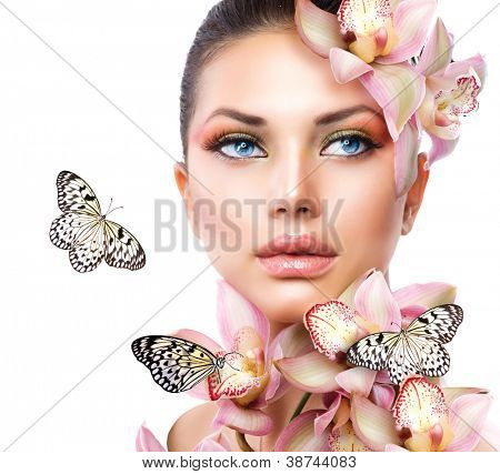 Beautiful Girl With Orchid Flowers and Butterfly. Beauty Face