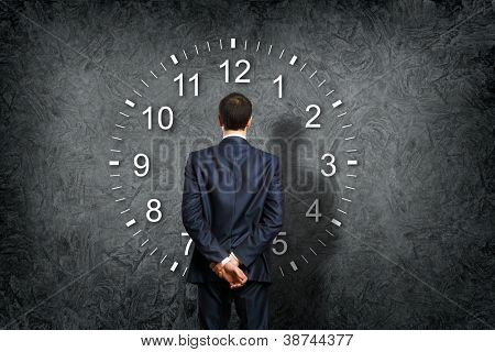 Businessman standing and making his choice between times