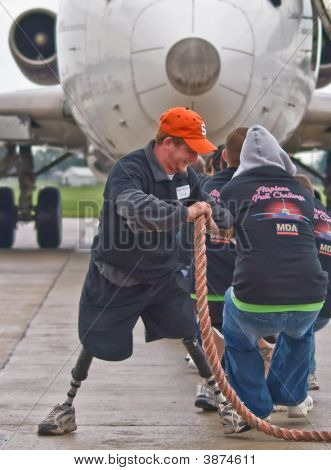 Disabled Man Pulling Plane