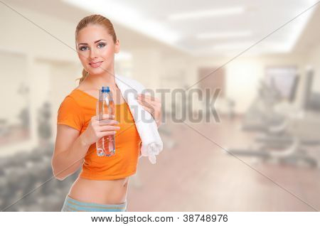Young beautiful smiling sporty woman