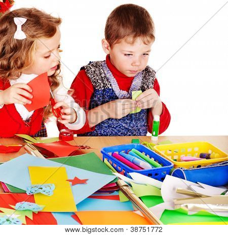 Children making card. Isolated on white.
