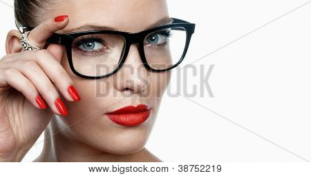 Young female wearing glasses. Space for text.