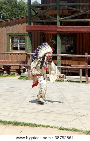 SCIEGNY, POLAND - JUNE 24: Sioux dancing ritual dance in Western City on June 24, 2012 in Sciegny, Poland. Western City is a replica of Wild West town located in Sciegny near Karpacz in Poland.