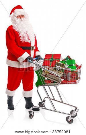 Santa Claus doing his Christmas shopping with a trolley full of gift wrapped presents, isolated on a white background.
