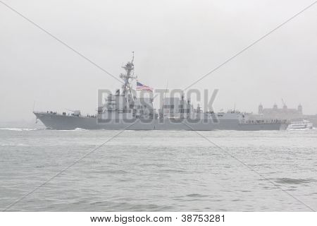 NEW YORK-OCT 9: USS Michael Murphy (DDG 112) departing New York Harbor in rain and fog after being commissioned into service in New York on October 9, 2012. Lt Murphy was a Navy SEAL killed in combat.