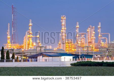 Architecture of Oil Refinery Plant with distillation tower at dusk