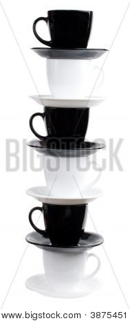 Tower From Six Black And White Coffee Cups And Saucers