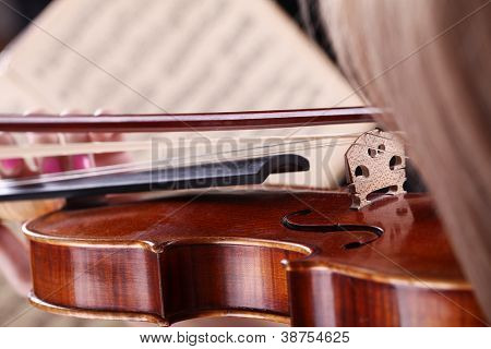 Close up of Notes, hair and violin