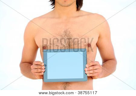 Man holding tablet pc in his hands on the beach