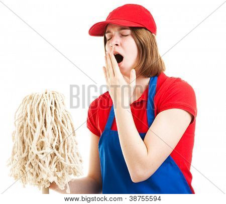 Tired teenage girl in her work uniform, holding a mop and yawning.  Isolated on white.