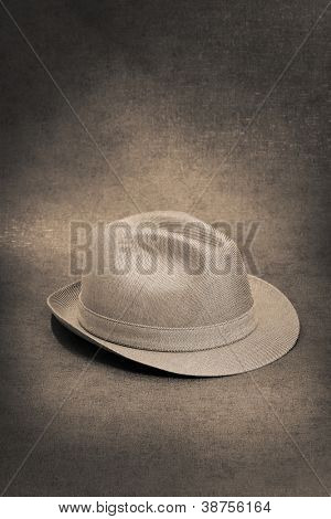 Sepia toned image of a vintage trilby hat.