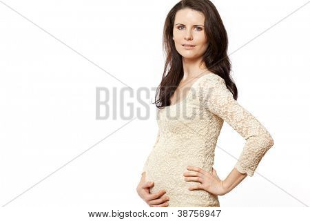 Young beautiful pregnant woman with long dark hair.