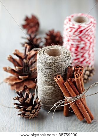 Cinnamon sticks, cones and kitchen string for christmas decor