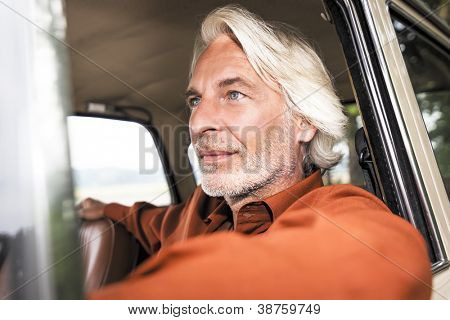 An image of a nice man in his historic car