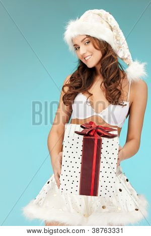 picture of cheerful santa helper girl in lingerie with gift box..