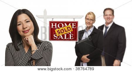Mixed Race People with Sold Home For Sale Real Estate Sign Isolated on a White Background.