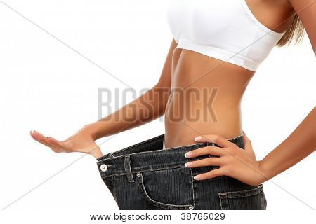 beautiful young woman with big jeans, isolated on white