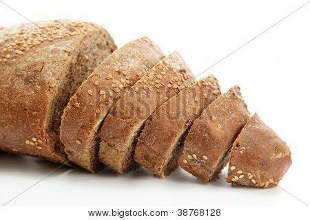 tasty sliced rye bread, isolated on white