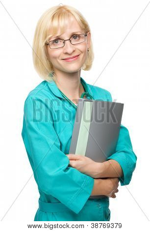 Portrait of a happy young attractive woman in doctor uniform holding files, isolated over white