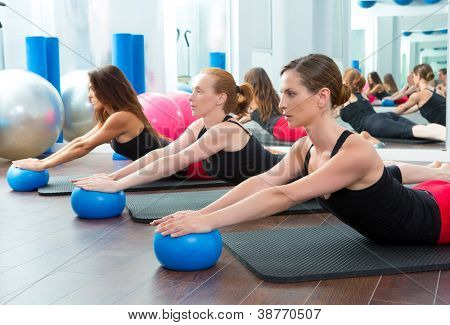 Aerobics pilates women with yoga balls in a row on fitness class
