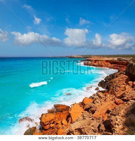Cala Saona rocky coast with aqua turquoise rough Mediterranean sea