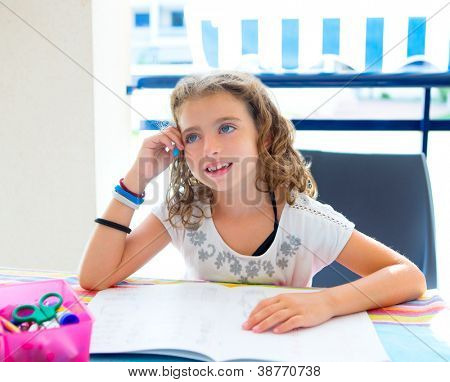 children kid girl smiling with homework in summer holding pencil