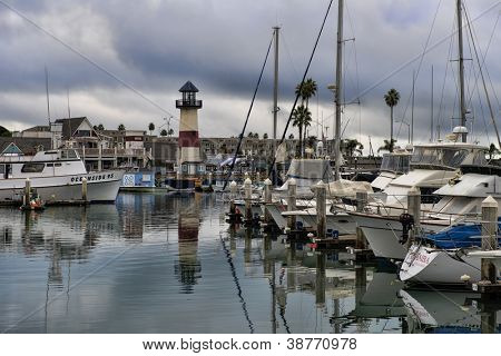 OCEANSIDE, CALIFORNIA - OCTOBER 21: Lighthouse and boats in calm waters as a storm passes through Southern California on October 21, 2012 in Oceanside, California, 40 miles north of San Diego.